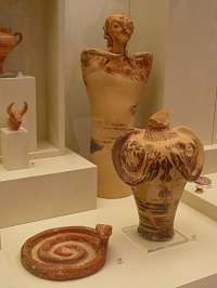 Athena was worshipped since Mycenaean times (1400-1200 BCE). In this picture from the Museum of Mycenae two of her sacred animals, the bull and the snake, are shown, along with female figurines (goddesses?). (Photo by author)