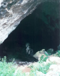Entrance to Skoteino cave showing giantess rock within