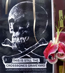 Photo on gates shows skull from Cross Bones excavation (photo: Max Reeves)