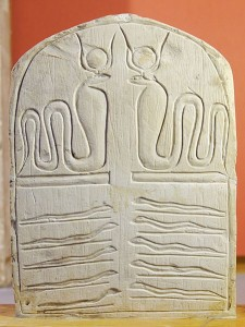 Stele representing the cobra-goddess (upper tier) and snakes (lower tier). Department of Egyptian antiquities, Louvre