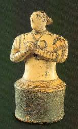 Priestess in worship
